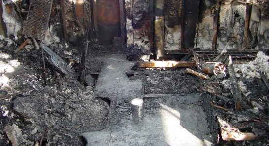 Can of evidence, and cleared path of one incendiary location, of the 91 Foot Yacht Explosion and Fire